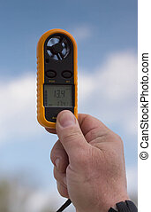 Anemometer in the hand of man,  wind speed 13.4 ms . Clouse-up