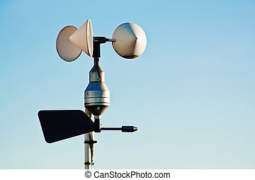 Anemometer on weather station measuring wind speed for...
