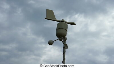 Anemometer over cloudy stormy sky