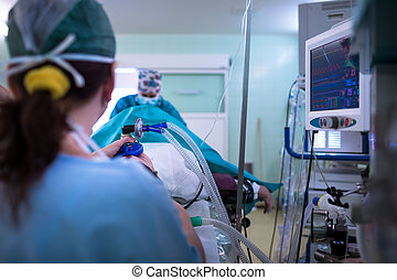 Anesthesia - patient under narcosis, breathing through a...
