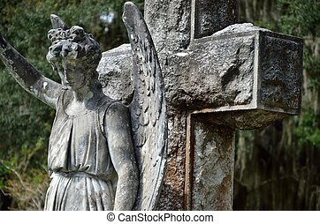 Angel and cross memorial statue - A century old cross and...
