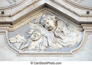 Angel, bass relief on the facade of Sant Andrea de Urso ...