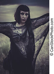 angel, brunette woman dressed with black spider web, sunset