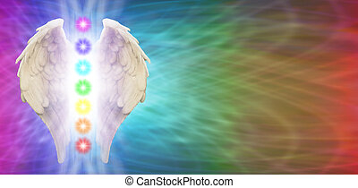Angel Wings on rainbow colored banner background with seven chakras positioned between wings