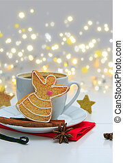 Angel Christmas Cookie with garland and coffee cup.