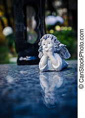 angel decoration on the grave
