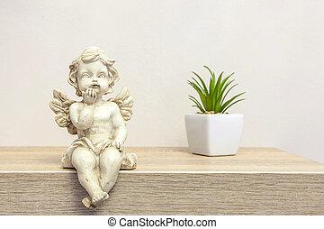 Angel figure on book shelf with copyspace