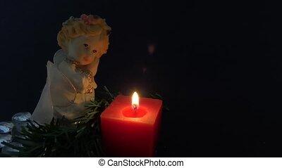 angel figurine in black background