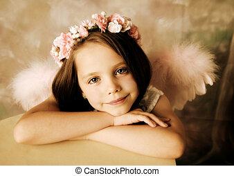 Angel Girl - Beautiful young girl wearing angel wings and...