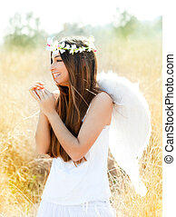 Angel girl in golden field with feather white wings - Angel ...