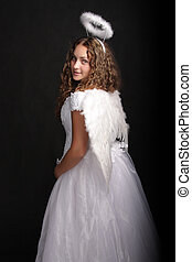 Angel looking over shoulder - Portrait of pretty girl in...