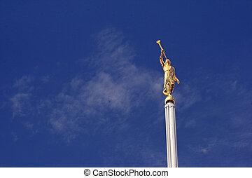 Angel Moroni statue on deep blue sky