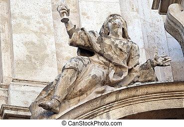 Angel on facade of San Marcello al Corso church in Rome, Italy