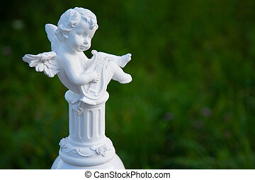 angel playing the harp in the garden