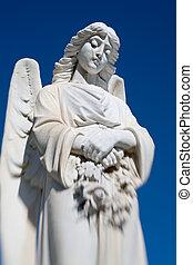 angel statue in an old rural Montana cemetery, shot against...