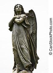 Angel statue - An=Statue of angel in cemetery looking up...