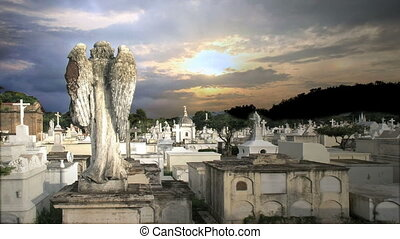 angel in a grave yard time lapse sunset