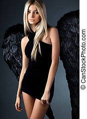 angel with black wings in grey background