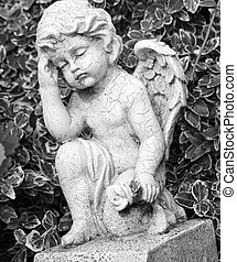 angel with flower in hand - cemetery sculpture