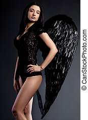 angel with wings in black background