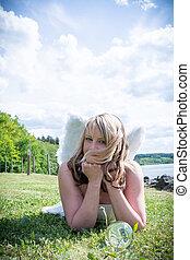 Angel woman in a meadow