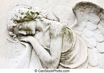 angelic image on tomb on monumental cemetery San Michele in Venice