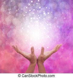 Angelic Pink Healing Energy - Female hands open flat on a...