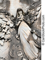 angelic relief, detail of tomb decoration on monumental cemetery in Italy, Europe