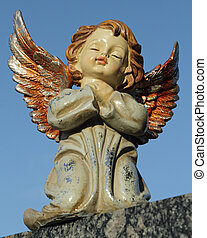 angelic sweet figurine with colorful wings isolated on blue sky