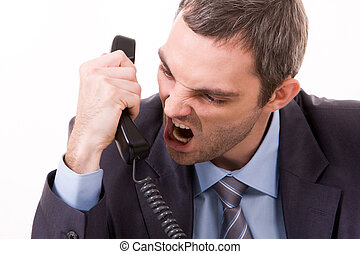 Anger - Image of aggressive boss yelling into telephone...