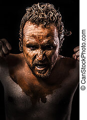 Anger man, Warrior young covered in mud