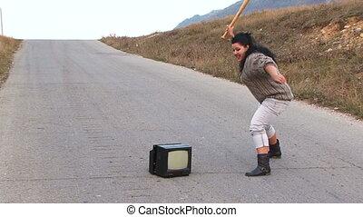 Anger old television and a baseball