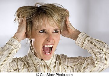 young business women grabbing her hair angry expression
