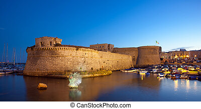 Angevin Castle of Gallipoli by night in Salento, Italy