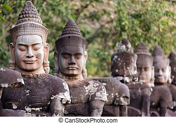 Angkor south door statues - Figures guardians statues of...