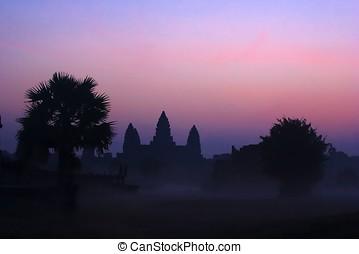 Angkor Wat  - Angkor wat sunrise in silhouette with mist.