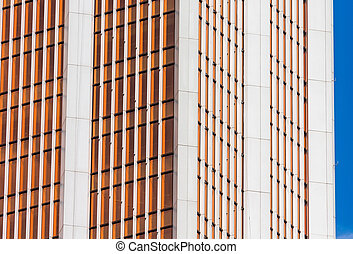 Angle glass red, burgundy, brown facades of a window of financial skyscrapers, a corner of a building close-up.