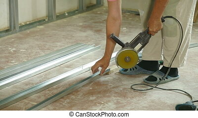 Angle Grinder Cutting Drywall Stud - Installation of gypsum...