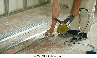 Angle Grinder Cutting Drywall Stud - Installation of gypsum...