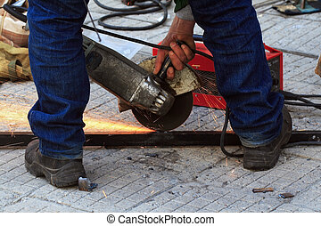 angle grinder cutting steel with sparks