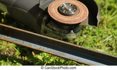 Angle grinder on grass