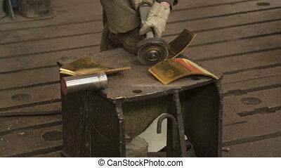 Angle grinder sharpens detail