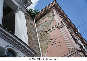 Angle of antique building. Architecture large building of antique roman style with pillars and blue sky
