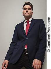 Angle view of a handsome young business man posing