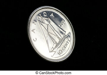 Angled reflective closeup of the front of a 2006 Canadian Dime (Bluenose Schooner) against a black background