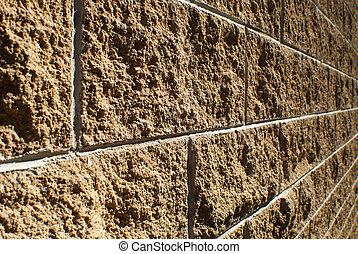 angled sandstone brick wall