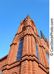 Angled to Cross top - Low angle shot of the corner spire of...