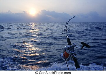 Angler boat big game fishing in saltwater ocean