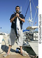 Angler fishing big game Albacore tuna on Mediterranean