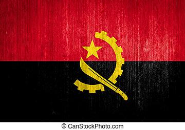 Angola Flag on wood background